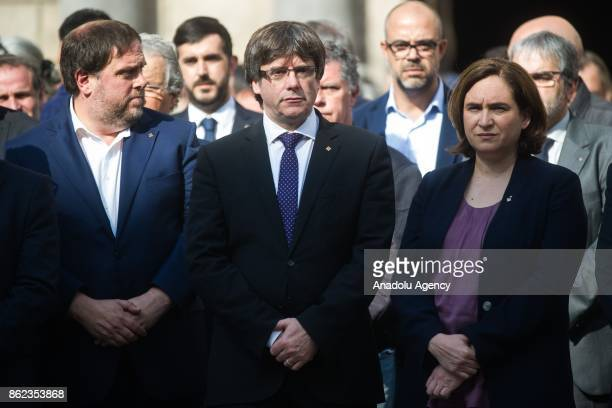 Catalan regional government president Carles Puigdemont Barcelona mayor Ada Colau and other officials attend a protest against the arrest of two...