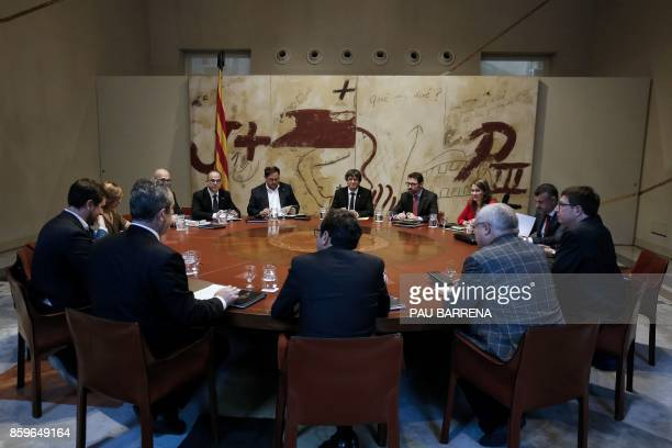 TOPSHOT Catalan regional government president Carles Puigdemont chairs a regional government meeting at the Generalitat Palace in Barcelona on...