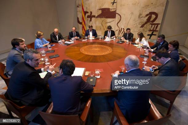 Catalan regional government president Carles Puigdemont chairs a regional government meeting at the Generalitat Palace in Barcelona on October 17...