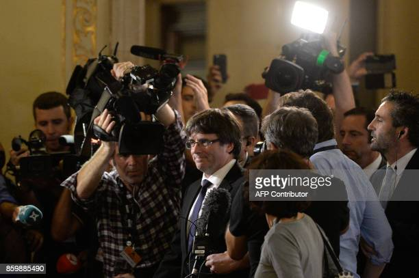 Catalan regional government president Carles Puigdemont leaves the Catalan regional parliament in Barcelona on October 10 2017 Catalonia's leader...