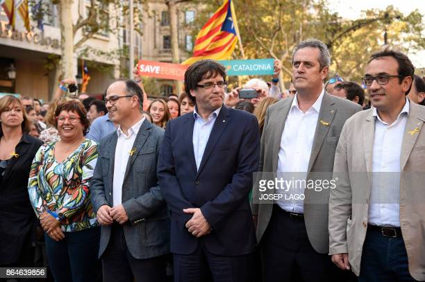 Catalan regional president Carles Puigdemont attends a demonstration on October 21 2017 in Barcelona to support two leaders of Catalan separatist...