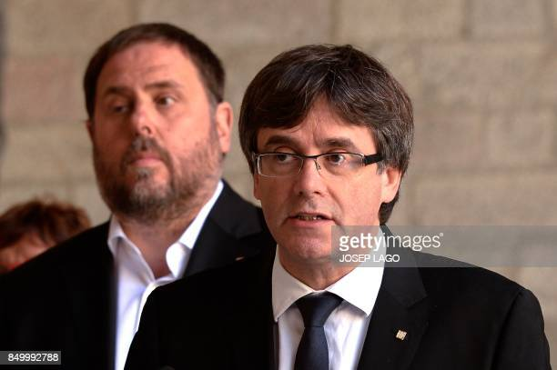 Catalan regional president Carles Puigdemont gives a speech in Barcelona on September 20 2017 Spanish police detained 13 Catalan government officials...