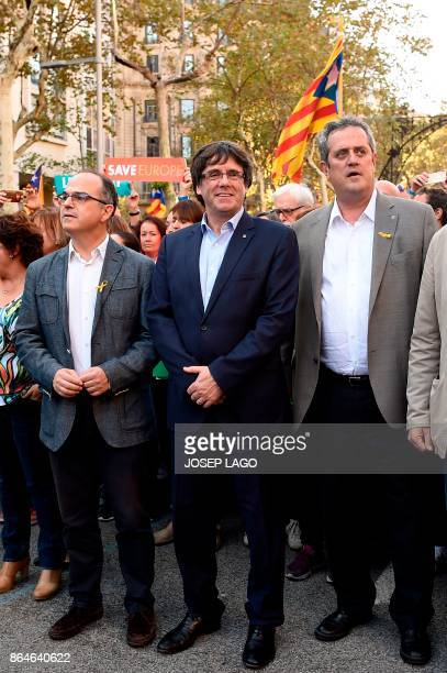 Catalan regional president Carles Puigdemont Interior Minister for the Catalan government Joaquim Forn and Catalan government spokesman Jordi Turull...