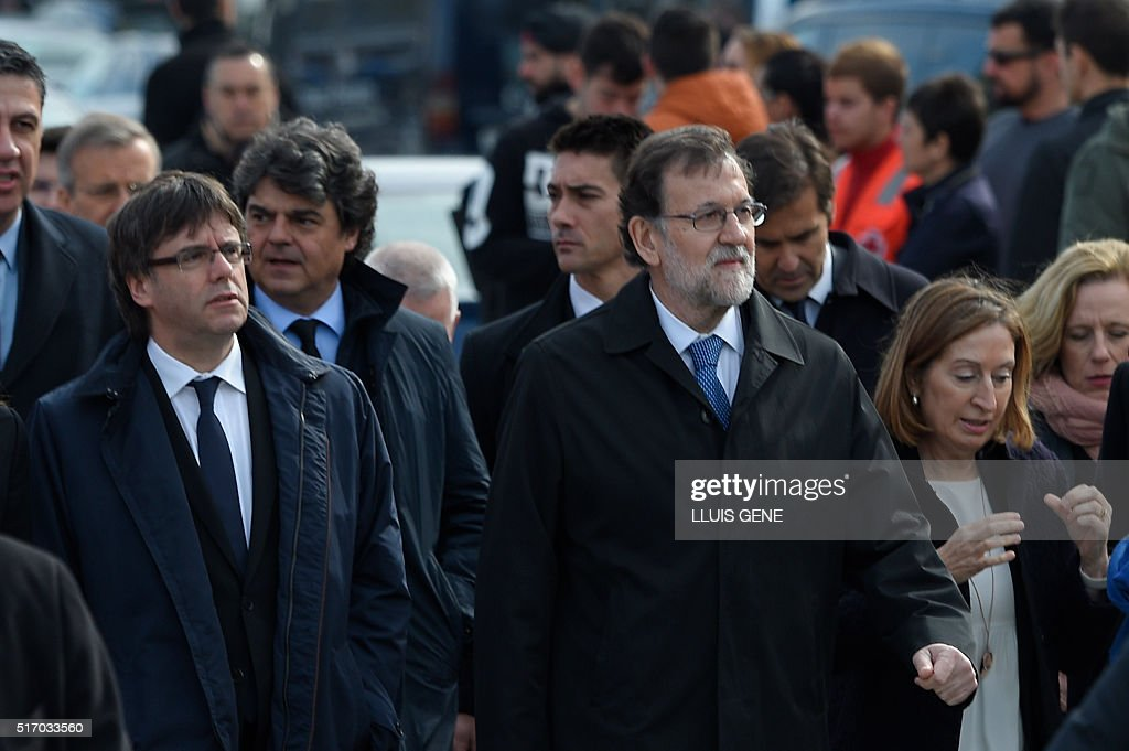 Catalan regional president Carles Puigdemont Spanish Prime Minister Mariano Rajoy and Spanish Minister of Public Works Ana Pastor arrive for a...