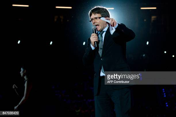 Catalan regional president Carles Puigdemont speaks during the official launch of the Catalan main separatist parties' campaign for an independence...