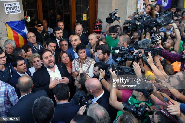 Catalan regional vicepresident and chief of Economy and Finance Oriol Junqueras talks to the people after leaving the Economy headquarters of...