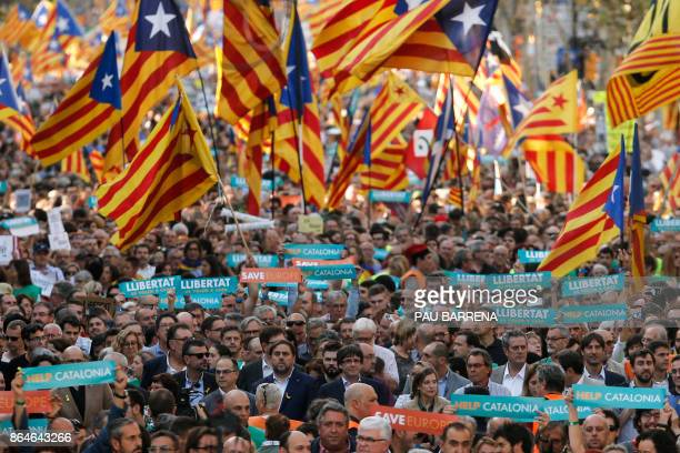 Catalan regional vicepresident and chief of Economy and Finance Oriol Junqueras and Catalan regional president Carles Puigdemont attend a...