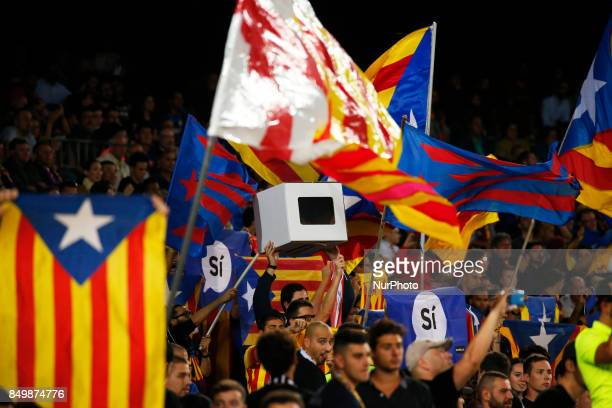 catalan supporters with catalan flags and one urn during La Liga match between FC Barcelona v SC Eibar in Barcelona on September 19 2017