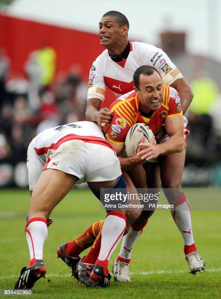 Catalans' Adam Mogg is tackled by St Helens' Willie Talau and Leon Pryce during the engage Super League match at Knowsley Road St Helens