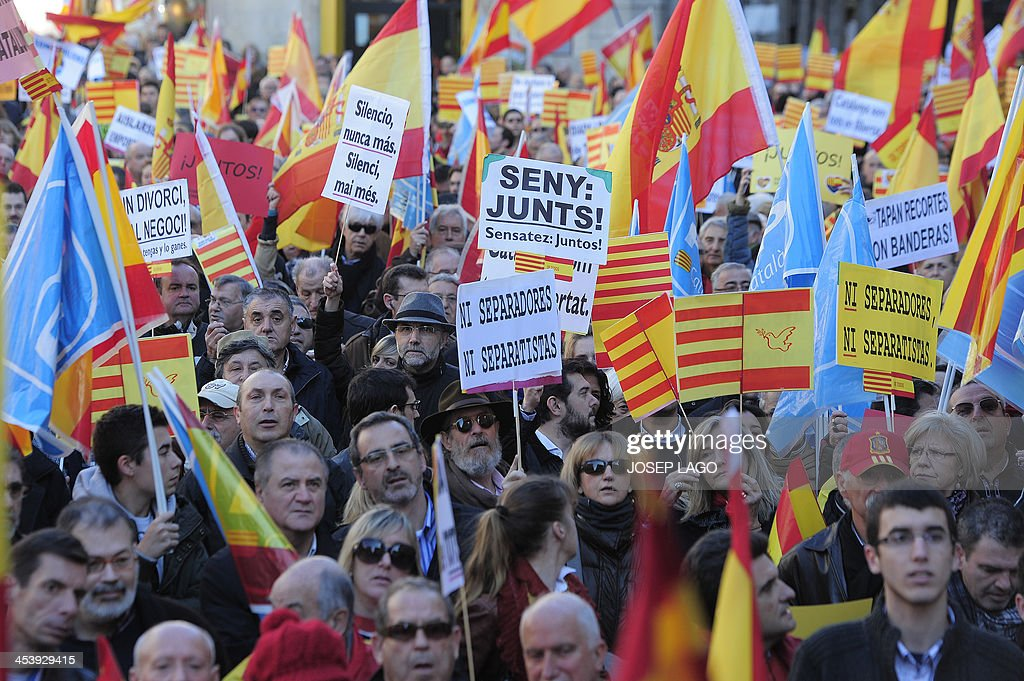 spain independence catalans against the regions independence hold spanish flags