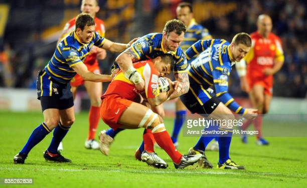 Catalans' Dimitri Pelo is tackled by Leeds Rhinos' Jamie Peacock and Danny McGuire during the engage Super League match at Headingley Carnegie Leeds