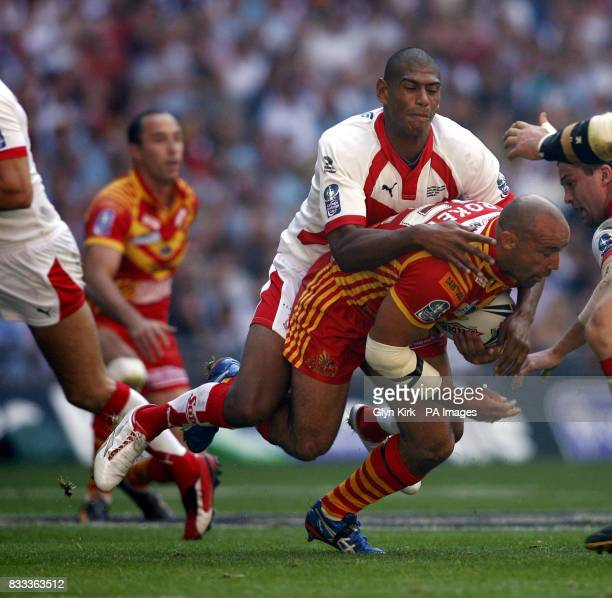 Catalans Dragons' Jason Croker is tackled by St Helens' Leon Pryce during the Carnegie Challenge Cup Final at Wembley Stadium London