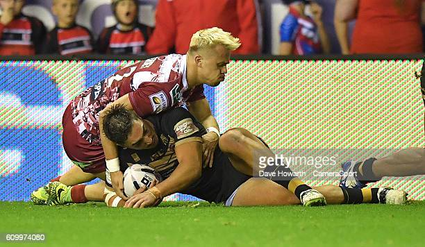 Catalans Dragons' Tony Gigot is tackled by Wigan Warriors' Liam Farrell during the First Utility Super League Super 8s Round 7 match between Wigan...