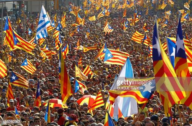Catalans holding independentist flags gather on Gran Via de les Corts Catalanes during celebrations of Catalonia National Day in Barcelona on...