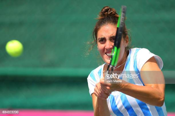 Catalina Pella of Argentina takes a shot during the third day of the Tennis Fed Cup American Zone Group 1 at Club Deportivo La Asuncion on February...