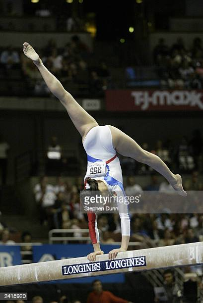 Catalina Ponor of Romania competes on the balance beam during the Women's Team Final of the World Gymnastics Championships on August 20 2003 at the...