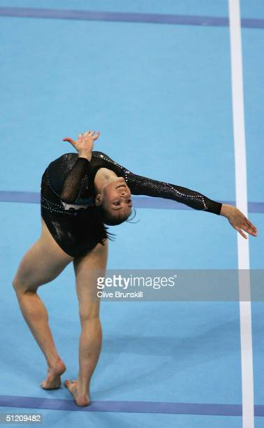 Catalina Ponor of Romania poses during her routine in the women's artistic gymnastics floor exercise finals on August 23 2004 during the Athens 2004...