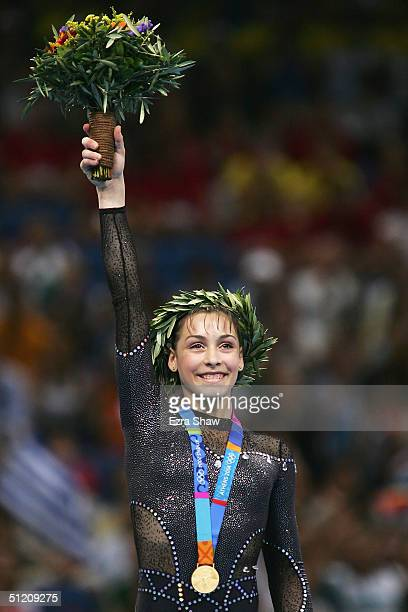 Catalina Ponor of Romania receives the gold medal for the women's artistic gymnastics balance beam event on August 23 2004 during the Athens 2004...