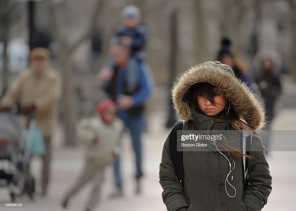 Catalina Sanchez originally from Colombia and now an international student living in Boston guarded herself against the wind and cold weather by...