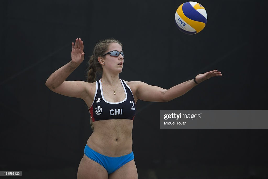 Catalina Zimmermann od Chile serves during the Women's Beach Volleyball Qualification as part of the I ODESUR South American Youth Games at Parque Temá‡tico de los Deportes on September 22, 2013 in Lima, Peru.