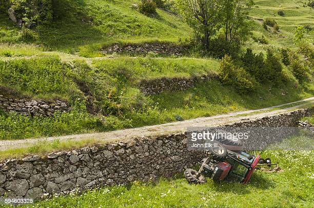 Catalonia landscape with overturned tractor