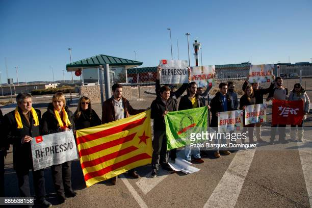 Catalonia proindependence supporters hold banners reading 'Republic' and 'Repression' before former members of the Catalan government leave Estremera...