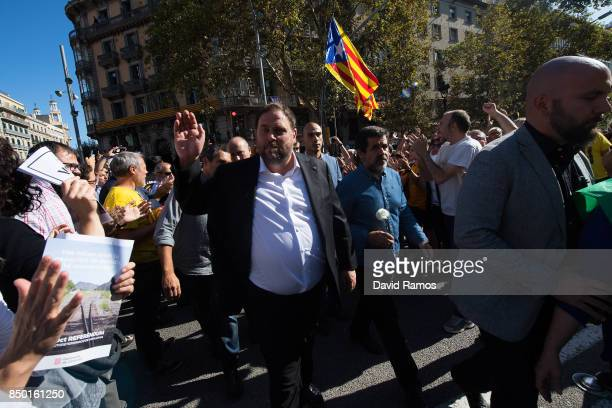 Catalonia VicePresident Oriol Junqueras arrives at the Catalan VicePresident and Economy office as police officers holds a searching operation inside...