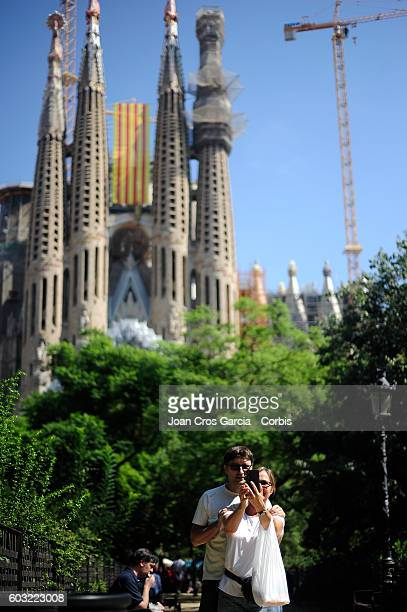 Catalonian flag is hung from La Sagrada Familia designed by Antoni Gaudí during the Catalonia National Day 'La Diada' on September 11 2016 in...