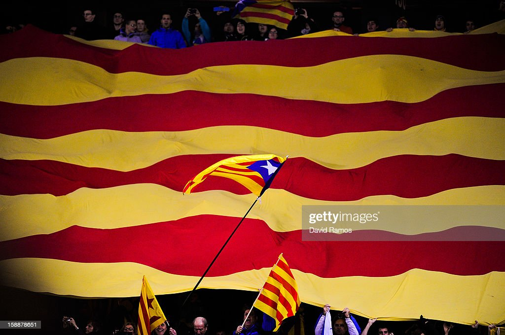 A Catalonian pro-indepence flag flies over a Catalan flag prior to a friendly match between Catalonia and Nigeria at Cornella-El Prat Stadium on January 2, 2013 in Barcelona, Spain.