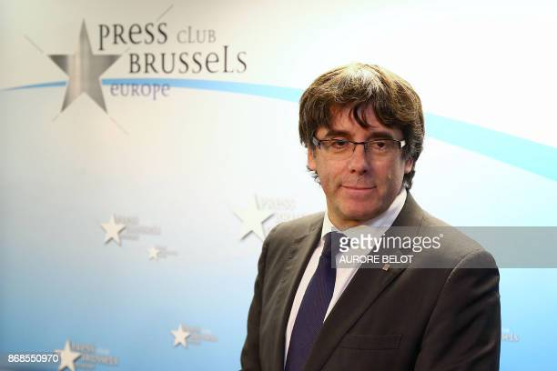 Catalonia's dismissed leader Carles Puigdemont along with other members of his dismissed government arrives to address a press conference at The...