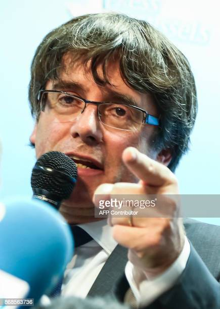 Catalonia's dismissed leader Carles Puigdemont along with other members of his dismissed government address a press conference at The Press Club in...