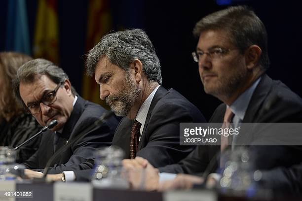 Catalonia's regional government president and leader of the Catalan Democratic Convergence party Artur Mas looks on past President of the General...