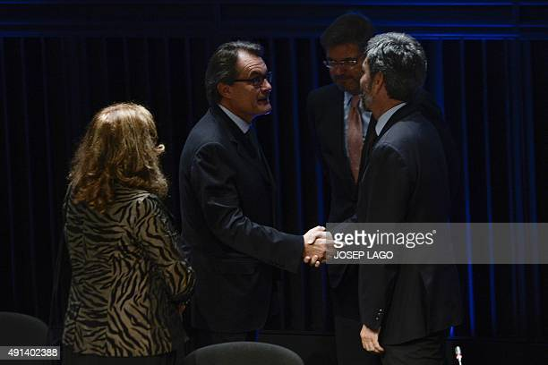 Catalonia's regional government president and leader of the Catalan Democratic Convergence party Artur Mas shakes hands with President of the General...