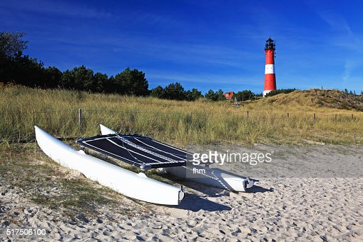 Catamaran and lighthouse on the beach at Sylt Island, Germany