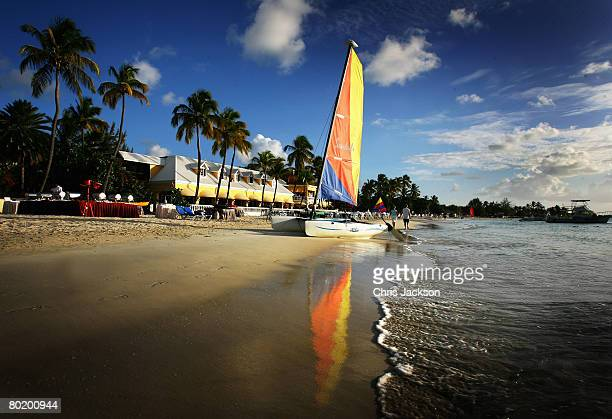 A catamaran with a colourful sail sits on the beach just outside St John's on March 10 2008 in Dickenson Bay Antigua