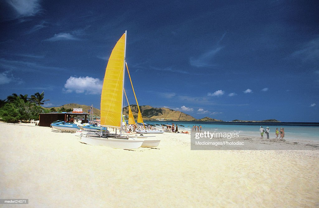 Catamarans and people on Martin Orient Beach, St. Martin, Caribbean