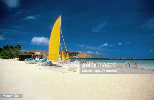 Catamarans and people on Martin Orient Beach, St. Martin, Caribbean