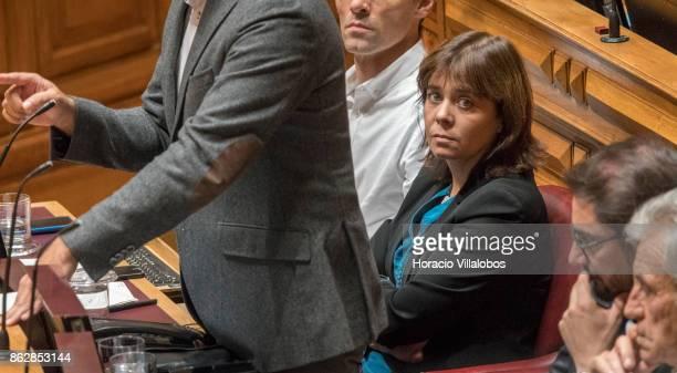 Catarina Soares Martins chairperson of the Bloco de Esquerda party since 2012 listens to Portuguese Prime Minister Antonio Costa answers to lawmakers...