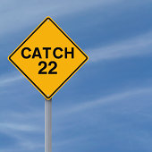 A modified road sign indicating Catch 22