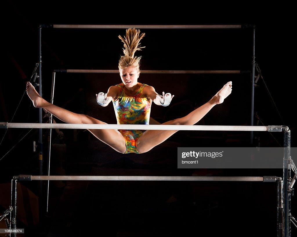 Catch it girl! Gymnast in flight : Stock Photo
