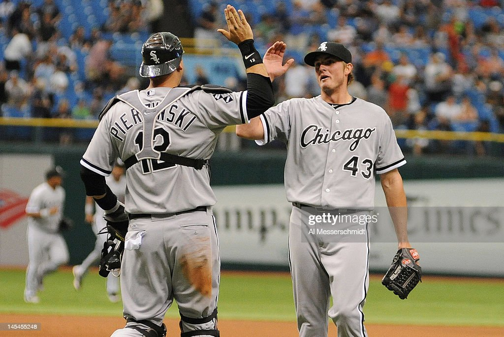 Catcher A. J. Pierzynski #12 of the Chicago White Sox celebrates with relief pitcher Addison Reed #43 a 4 - 3 victory against the Tampa Bay Rays May 30, 2012 at Tropicana Field in St. Petersburg, Florida.