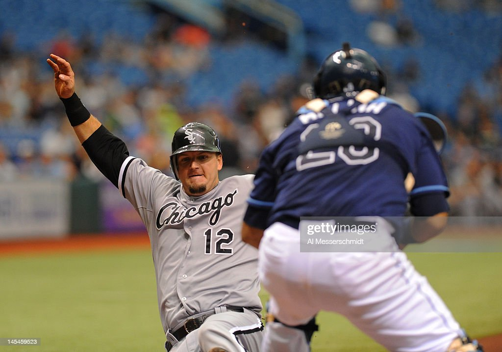 Catcher A. J. Pierzynski #12 of the Chicago White Sox slides into home plate for a run in the third inning against the Tampa Bay Rays May 30, 2012 at Tropicana Field in St. Petersburg, Florida.