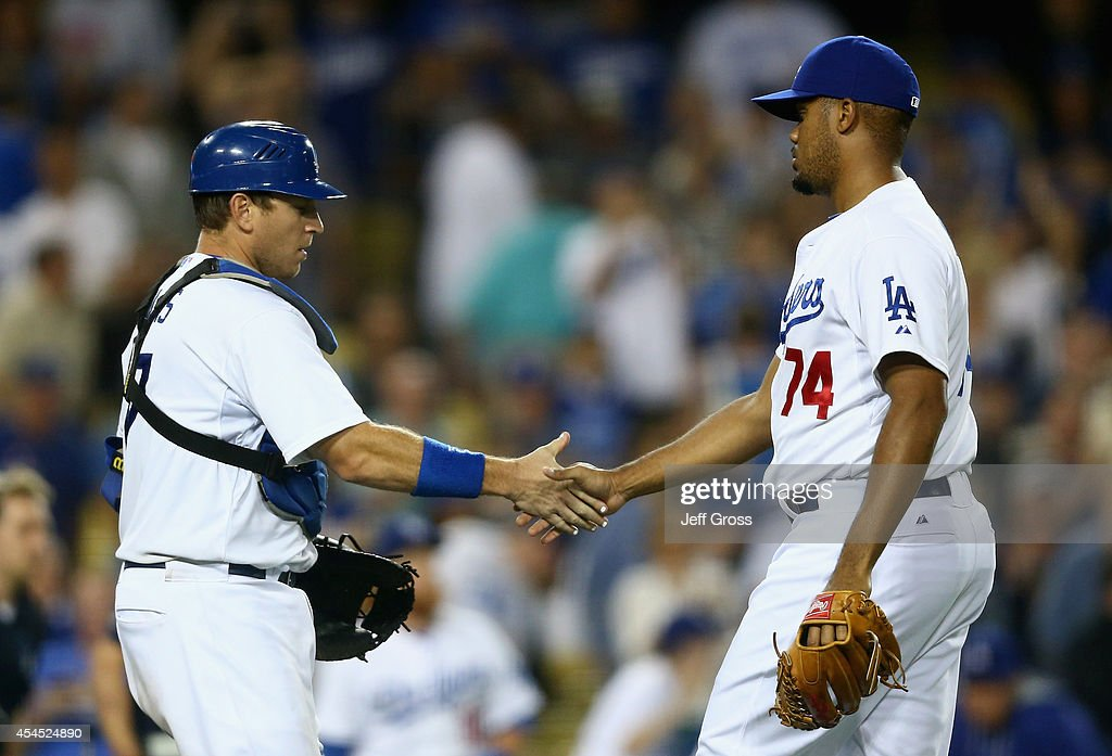 Catcher A.J. Ellis #17 and closing pitcher <a gi-track='captionPersonalityLinkClicked' href=/galleries/search?phrase=Kenley+Jansen&family=editorial&specificpeople=5751411 ng-click='$event.stopPropagation()'>Kenley Jansen</a> #74 of the Los Angeles Dodgers celebrate the Dodgers' 4-1 victory over the Washington Nationals at Dodger Stadium on September 2, 2014 in Los Angeles, California.