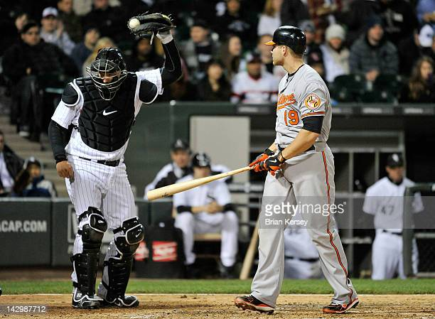 Catcher AJ Pierzynski of the Chicago White Sox holds up the ball for the umpire after Chris Davis of the Baltimore Orioles struck out on a foul tip...