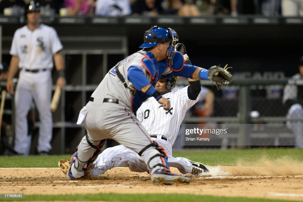 Catcher <a gi-track='captionPersonalityLinkClicked' href=/galleries/search?phrase=A.J.+Pierzynski&family=editorial&specificpeople=204486 ng-click='$event.stopPropagation()'>A.J. Pierzynski</a> #12 of the Texas Rangers (L) blocks home plate before tagging out <a gi-track='captionPersonalityLinkClicked' href=/galleries/search?phrase=Alexei+Ramirez&family=editorial&specificpeople=690568 ng-click='$event.stopPropagation()'>Alexei Ramirez</a> #10 of the Chicago White Sox who tried to score from second base on a single hit by teammate Paul Konerko #14 during the fourth inning of the 2013 Civil Rights Game at U.S. Cellular Field on August 24, 2013 in Chicago, Illinois.