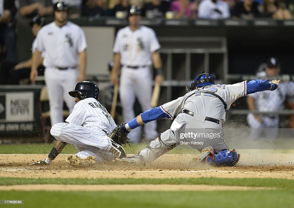 Catcher <a gi-track='captionPersonalityLinkClicked' href=/galleries/search?phrase=A.J.+Pierzynski&family=editorial&specificpeople=204486 ng-click='$event.stopPropagation()'>A.J. Pierzynski</a> #12 of the Texas Rangers (R) tags out <a gi-track='captionPersonalityLinkClicked' href=/galleries/search?phrase=Alexei+Ramirez&family=editorial&specificpeople=690568 ng-click='$event.stopPropagation()'>Alexei Ramirez</a> #10 of the Chicago White Sox at home plate as he tries to score from second base on a single hit by teammate Paul Konerko #14 during the fourth inning of the 2013 Civil Rights Game at U.S. Cellular Field on August 24, 2013 in Chicago, Illinois.