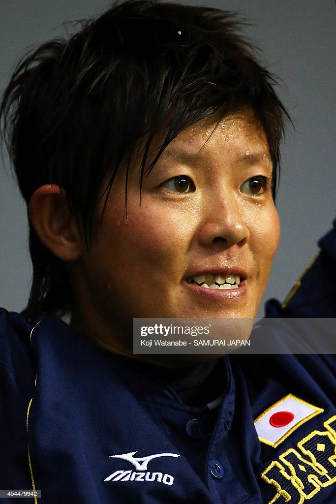 Catcher <a gi-track='captionPersonalityLinkClicked' href=/galleries/search?phrase=Akane+Nakamura&family=editorial&specificpeople=13537226 ng-click='$event.stopPropagation()'>Akane Nakamura</a> #12 of Japan the IBAF Women's Baseball World Cup Group A game between Japan and Australia at Sun Marine Stadium on September 1, 2014 in Miyazaki, Japan.