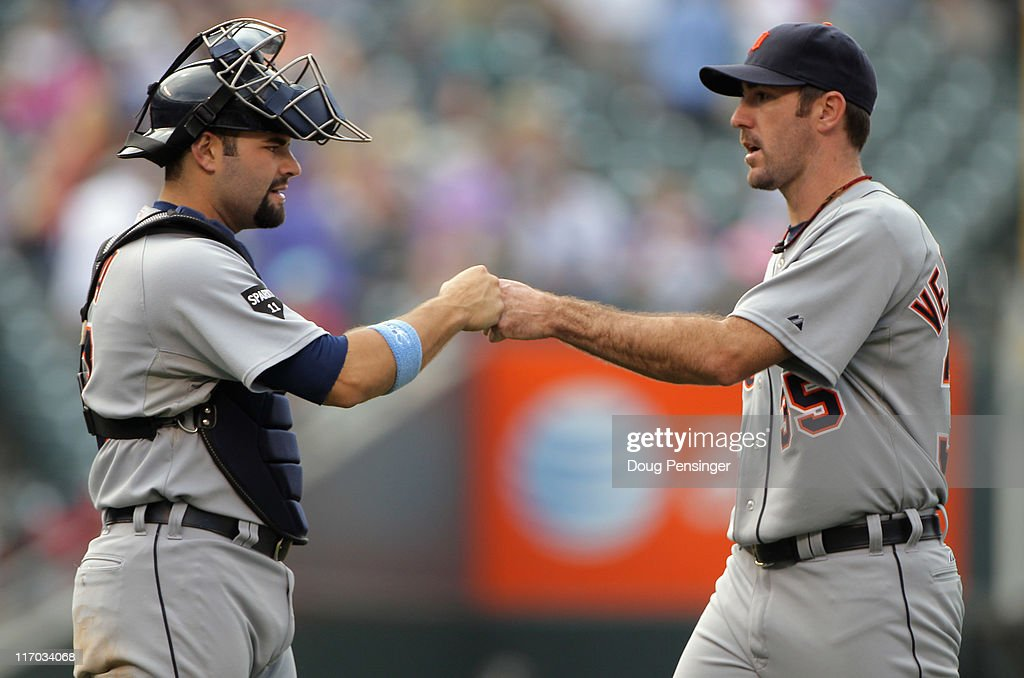 Catcher Alex Avila and starting pitcher Justin Verlander of the Detroit Tigers celebrate after their victory over the Colorado Rockies at Coors Field...