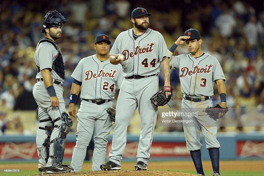 Catcher <a gi-track='captionPersonalityLinkClicked' href=/galleries/search?phrase=Alex+Avila&family=editorial&specificpeople=5749211 ng-click='$event.stopPropagation()'>Alex Avila</a> #13, <a gi-track='captionPersonalityLinkClicked' href=/galleries/search?phrase=Miguel+Cabrera&family=editorial&specificpeople=202141 ng-click='$event.stopPropagation()'>Miguel Cabrera</a> #24, pitcher <a gi-track='captionPersonalityLinkClicked' href=/galleries/search?phrase=Joba+Chamberlain&family=editorial&specificpeople=4391682 ng-click='$event.stopPropagation()'>Joba Chamberlain</a> #44 and <a gi-track='captionPersonalityLinkClicked' href=/galleries/search?phrase=Ian+Kinsler&family=editorial&specificpeople=538104 ng-click='$event.stopPropagation()'>Ian Kinsler</a> #3 of the Detroit Tigers wait for manager Brad Ausmus to come to the mound in the 10th inning during the MLB game against the Los Angeles Dodgers at Dodger Stadium on April 8, 2014 in Los Angeles, California. The Dodgers defeated the Tigers 3-2 in 10 innings.