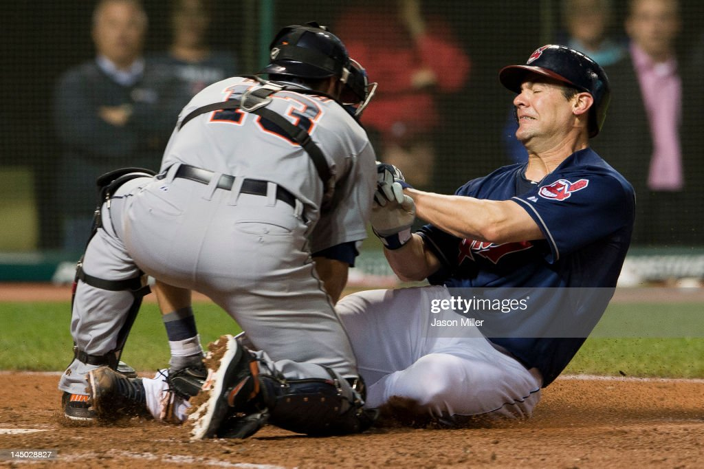 Catcher <a gi-track='captionPersonalityLinkClicked' href=/galleries/search?phrase=Alex+Avila&family=editorial&specificpeople=5749211 ng-click='$event.stopPropagation()'>Alex Avila</a> #13 of the Detroit Tigers tags out <a gi-track='captionPersonalityLinkClicked' href=/galleries/search?phrase=Casey+Kotchman&family=editorial&specificpeople=240573 ng-click='$event.stopPropagation()'>Casey Kotchman</a> #35 of the Cleveland Indians at home plate during the eighth inning at Progressive Field on May 22, 2012 in Cleveland, Ohio. The Indians defeated the Tigers 5-3.